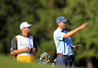 PONTE VEDRA BEACH, FL - MAY 11:  Matt Kuchar (R) of the United States talks with caddie Lance Bennett (L) before hitting an approach shot on the 14th hole during the second round of THE PLAYERS Championship held at THE PLAYERS Stadium course at TPC Sawgra