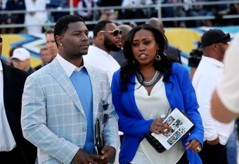 SAN DIEGO, CA - MAY 11:  LaDanian Tomlinson pays tribute to former NFL star Junior Seau during a public memorial at Qualcomm Stadium May 11, 2012 in San Diego, California. Seau, who played for various NFL teams including the San Diego Chargers, Miami Dolp
