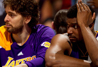 DENVER, CO - MAY 10:  Pau Gasol #16 of the Los Angeles Lakers (L) and Andrew Bynum #17 react from the bench against the Denver Nuggets in Game Six of the Western Conference Quarterfinals in the 2012 NBA Playoffs at Pepsi Center on May 10, 2012 in Denver,