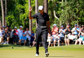 PONTE VEDRA BEACH, FL - MAY 11:  Tiger Woods of the United States waves after putting on the eighth green during the second round of THE PLAYERS Championship held at THE PLAYERS Stadium course at TPC Sawgrass on May 11, 2012 in Ponte Vedra Beach, Florida.