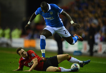 WIGAN, ENGLAND - APRIL 11:  Phil Jones of Manchester United injures himself in a tackle on Mohamed Diame of Wigan during the Barclays Premier League match between Wigan Athletic and Manchester United at the DW Stadium on April 11, 2012 in Wigan, England.