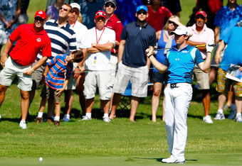 PONTE VEDRA BEACH, FL - MAY 11: Rory McIlroy of Northern Ireland reacts to his approach shot on the 16th hole during the second round of THE PLAYERS Championship held at THE PLAYERS Stadium course at TPC Sawgrass on May 11, 2012 in Ponte Vedra Beach, Flor