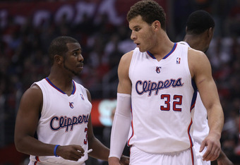 LOS ANGELES, CA - DECEMBER 30:  Chris Paul #3 and Blake Griffin #32 of the Los Angeles Clippers confer during hte game with the Chicago Bulls at Staples Center on December 30, 2011 in Los Angeles, California.  The Bulls won 114-101.  NOTE TO USER: User ex