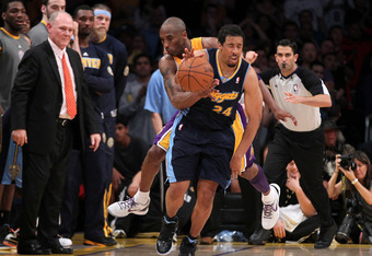 LOS ANGELES, CA - MAY 08:  Andre Miller #24 of the Denver Nuggets is fouled from behind by Kobe Bryant #24 of the Los Angeles Lakers in the fourth quarter in Game Five of the Western Conference Quarterfinals in the 2012 NBA Playoffs on May 8, 2012 at Stap