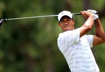 PONTE VEDRA BEACH, FL - MAY 12:  Tiger Woods of the United States hits his tee shot on the ninth hole during the third round of THE PLAYERS Championship held at THE PLAYERS Stadium course at TPC Sawgrass on May 12, 2012 in Ponte Vedra Beach, Florida.  (Ph