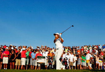 PONTE VEDRA BEACH, FL - MAY 12: Kevin Na of the United States hits his tee shot on the 18th hole during the third round of THE PLAYERS Championship held at THE PLAYERS Stadium course at TPC Sawgrass on May 12, 2012 in Ponte Vedra Beach, Florida.  (Photo b