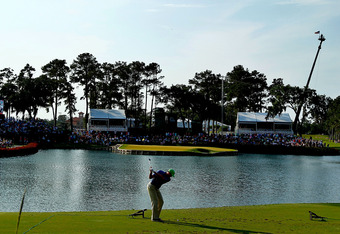 PONTE VEDRA BEACH, FL - MAY 12:  Matt Kuchar of the United States hits his tee shot on the 17th hole during the third round of THE PLAYERS Championship held at THE PLAYERS Stadium course at TPC Sawgrass on May 12, 2012 in Ponte Vedra Beach, Florida.  (Pho