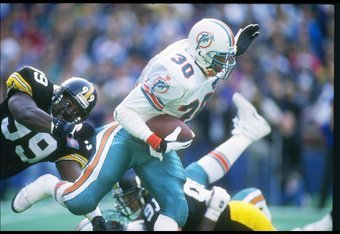 20 Nov 1994:  Runningback Bernie Parmalee of the Miami Dolphins runs down the field during a game against the Pittsburgh Steelers at Three Rivers Stadium in Pittsburgh, Pennsylvania.   The Steelers won the game 16-13 in overtime. Mandatory Credit: Scott H