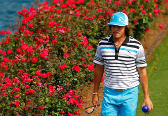 PONTE VEDRA BEACH, FL - MAY 12:  Rickie Fowler of the United States walks to the 17th green during the third round of THE PLAYERS Championship held at THE PLAYERS Stadium course at TPC Sawgrass on May 12, 2012 in Ponte Vedra Beach, Florida.  (Photo by Mik
