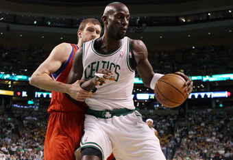 BOSTON, MA - MAY 12: Kevin Garnett #5 of the Boston Celtics tries to get around Spencer Hawes #00 of the Philadelphia 76ers  in Game One of the Western Conference Semifinals in the 2012 NBA Playoffs on May 12, 2012 at TD Garden in Boston, Massachusetts. N