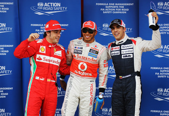 BARCELONA, SPAIN - MAY 12:  Pole sitter Lewis Hamilton (C) of Great Britain and McLaren celebrates in parc ferme with second placed Pastor Maldonado (R) of Venezuela and Williams and third placed  Fernando Alonso (L) of Spain and Ferrari following qualify