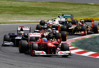 BARCELONA, SPAIN - MAY 13:  Fernando Alonso of Spain and Ferrari takes the lead from Pastor Maldonado of Venezuela and Williams at the start of the Spanish Formula One Grand Prix at the Circuit de Catalunya on May 13, 2012 in Barcelona, Spain.  (Photo by