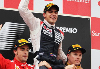 BARCELONA, SPAIN - MAY 13:  Race winner Pastor Maldonado (C) of Venezuela and Williams celebrates on the shoulders of second placed Fernando Alonso (L) of Spain and Ferrari and third placed Kimi Raikkonen (R) of Finland and Lotus following the Spanish For
