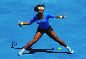 MADRID, SPAIN - MAY 13:  Serena Williams of USA plays a forehand against Victoria Azarenka of Belarus in the Womens' Singles Final on Day Nine of the Mutua Madrilena Madrid Open at the Caja Magica on May 13, 2012 in Madrid, Spain.  (Photo by Mike Hewitt/G