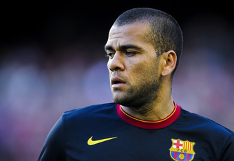 BARCELONA, SPAIN - MAY 02:  Dani Alves of FC Barcelona looks on during the warm up prior to the La Liga match between FC Barcelona and Malaga CF at Camp Nou Stadium on May 2, 2012 in Barcelona, Spain. FC Barcelona won 4-1.  (Photo by David Ramos/Getty Ima