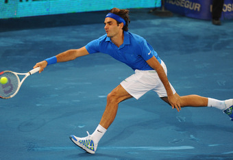 MADRID, SPAIN - MAY 11:  Roger Federer of Switzerland in action during his quarter final with David Ferrer of Spain during Day Seven of the Mutua Madrilena Madrid Open at the Caja Magica on May 11, 2012 in Madrid, Spain.  (Photo by Mike Hewitt/Getty Image