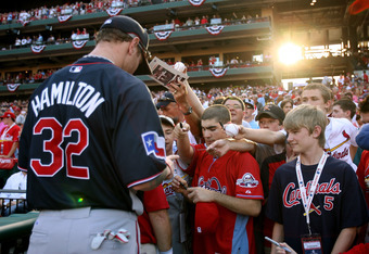 ST LOUIS, MO - JULY 13:  American League All-Star Josh Hamilton of the Texas Rangers signs autographs for fans before the State Farm Home Run Derby at Busch Stadium on July 13, 2009 in St. Louis, Missouri.  (Photo by Elsa/Getty Images)