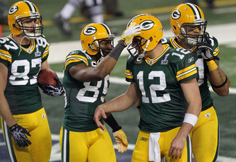 ARLINGTON, TX - FEBRUARY 06: Jordy Nelson #87, Greg Jennings #85 and Aaron Rodgers #12 of the Green Bay Packers celebrate after an 8 yard touchdown pass to Jennings against the Pittsburgh Steelers during Super Bowl XLV at Cowboys Stadium on February 6, 20