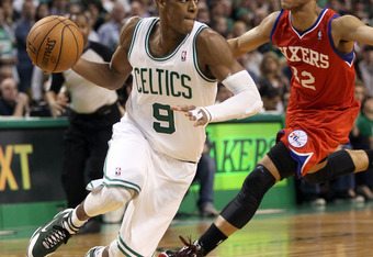 BOSTON, MA - MAY 12:  Rajon Rondo #9 of the Boston Celtics avoids Evan Turner #12 of the Philadelphia 76ers in the final seconds of the of Game One of the Western Conference Semifinals in the 2012 NBA Playoffs on May 12, 2012 at TD Garden in Boston, Massa
