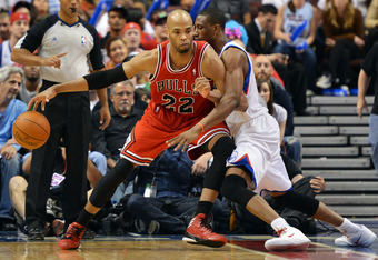 PHILADELPHIA, PA - MAY 06: Taj Gibson #22 of the Chicago Bulls loses control of the ball while driving on Thaddeus Young #21 of the Philadelphia 76ers in Game Four of the Eastern Conference Quarterfinals in the 2012 NBA Playoffs at the Wells Fargo Center
