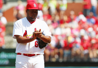 ST. LOUIS, MO - APRIL 19: Reliever Victor Marte #66 of the St. Louis reacts to giving up a home run against the Cincinnati Reds Cardinals at Busch Stadium on April 19, 2012 in St. Louis, Missouri. The Reds defeated the Cardinals 6-3.  (Photo by Dilip Vish