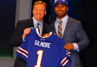 NEW YORK, NY - APRIL 26:  Stephon Gilmore of South Carolina holds up a jersey as he stands on stage with NFL Commissioner Roger Goodell after he was selected #10 overall by the Buffalo Bills in the first round of the 2012 NFL Draft at Radio City Music Hal
