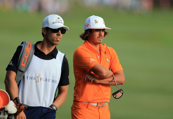 PONTE VEDRA BEACH, FL - MAY 13:  Rickie Fowler of the United States plays his second shot at the par 4, 18th hole during the final round of THE PLAYERS Championship held at THE PLAYERS Stadium course at TPC Sawgrass on May 13, 2012 in Ponte Vedra Beach, F