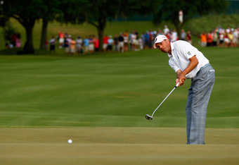 PONTE VEDRA BEACH, FL - MAY 13:  Matt Kuchar of the United States putts on the 18th hole during the final round of THE PLAYERS Championship held at THE PLAYERS Stadium course at TPC Sawgrass on May 13, 2012 in Ponte Vedra Beach, Florida.  (Photo by Mike E