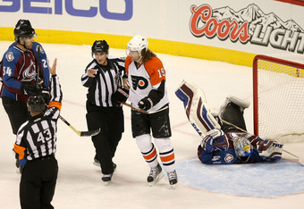 Scott Hartnell gets escorted to the sin bin.