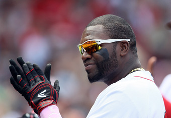 BOSTON, MA - MAY 13:  David Ortiz #34 of the Boston Red Sox salutes a fan during the game against the Cleveland Indians on April 21, 2012 at Fenway Park in Boston, Massachusetts.  (Photo by Elsa/Getty Images)