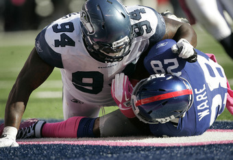 EAST RUTHERFORD, NJ - OCTOBER 9:  Anthony Hargrove #94 of the Seattle Seahawks tackles Danny Ware #28 of the New York Giants in the end zone for a saftey during a game at MetLife Stadium on October 9, 2011 in East Rutherford, New Jersey. (Photo by Rich Sc