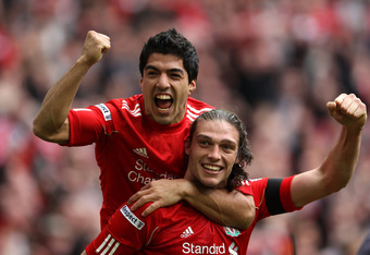 LONDON, ENGLAND - APRIL 14:  Andy Carroll of Liverpool celebrates with Luis Suarez as he scores their second goal during the FA Cup with Budweiser Semi Final match between Liverpool and Everton at Wembley Stadium on April 14, 2012 in London, England.  (Ph