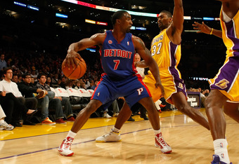 LOS ANGELES, CA - NOVEMBER 17:  Ben Gordon #7 of the Detroit Pistons is defended by Ron Artest #37 and Lamar Odom #7 of the Los Angeles Lakers in the first half at Staples Center on November 17, 2009 in Los Angeles, California. NOTE TO USER: User expressl