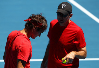 MELBOURNE, AUSTRALIA - JANUARY 15:  Roger Federer of Switzerland and his coach Paul Annacone chat during a practice session ahead of the 2012 Australian Open at Melboure Park on January 15, 2012 in Melbourne, Australia.  (Photo by Mark Dadswell/Getty Imag