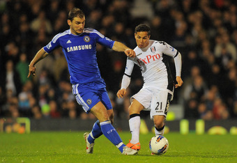 LONDON, ENGLAND - APRIL 09: Branislav Ivanovic of Chelsea (L) and Kerim Frei of Fulham compete for the ball during the Barclays Premier League match between Fulham and Chelsea at Craven Cottage on April 9, 2012 in London, England.  (Photo by Mike Hewitt/G