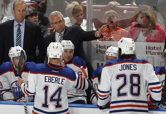 SUNRISE, FL - MARCH 23: Head coach Tom Renney of the Edmonton Oilers talks to the players during a time out against the Florida Panthers on March 23, 2012 at the BankAtlantic Center in Sunrise, Florida. The Oilers defeated the Panthers 2-1 in a shoot out.