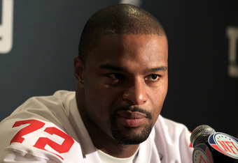 INDIANAPOLIS, IN - FEBRUARY 02:  Osi Umenyiora #72 of the New York Giants answers questions from the press during a media availability session for Super Bowl XLVI at the Indianapolis Downtown Marriott on February 2, 2012 in Indianapolis, Indiana.  (Photo