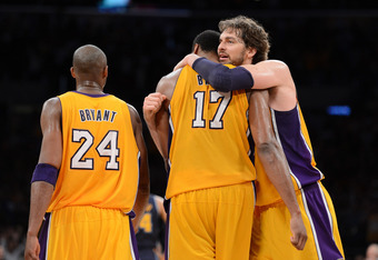 LOS ANGELES, CA - MAY 12:  (R-L) Pau Gasol #16 hugs teammate Andrew Bynum #17 of the Los Angeles Lakers in the fourth quarter alongside Kobe Bryant #24 while taking on the Denver Nuggets in Game Seven of the Western Conference Quarterfinals in the 2012 NB