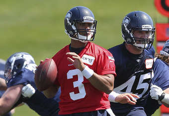 RENTON, WA - MAY 11:  Quarterback Russell Wilson #3 of the Seattle Seahawks looks to pass during minicamp at the Virginia Mason Athletic Center on May 11, 2012 in Renton, Washington. (Photo by Otto Greule Jr/Getty Images)