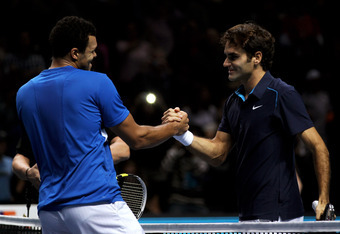 LONDON, ENGLAND - NOVEMBER 27:  Roger Federer (R) of Switzerland is congratulated by opponent Jo-Wilfried Tsonga of France following his victory in the men's final singles match during the Barclays ATP World Tour Finals at the O2 Arena on November 27, 201