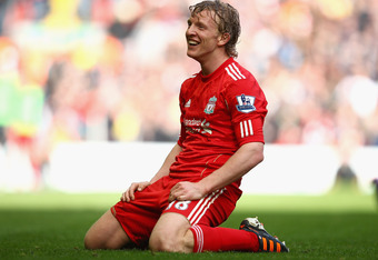 LIVERPOOL, ENGLAND - MARCH 03:  Dirk Kuyt of Liverpool reacts during the Barclays Premier League match between Liverpool and Arsenal at Anfield on March 3, 2012 in Liverpool, England.  (Photo by Clive Mason/Getty Images)