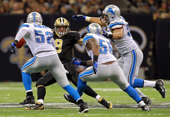 NEW ORLEANS, LA - JANUARY 07:   Drew Brees #9 of the New Orleans Saints tries to avoid getting tackled by Justin Durant #52,  Stephen Tulloch #55 and Sammie Lee Hill #91 of the Detroit Lions during their 2012 NFC Wild Card Playoff game at Mercedes-Benz Su