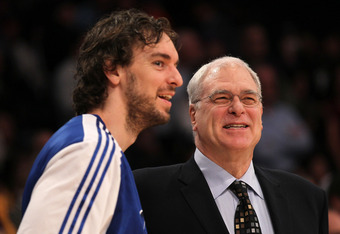 LOS ANGELES, CA - JANUARY 11:   Head coach Phil Jackson and Pau Gasol #16 of the Los Angeles Lakers laugh before the game with the Cleveland Cavaliers at Staples Center on January 11, 2011 in Los Angeles, California.  The Lakers won 112-57.  NOTE TO USER: