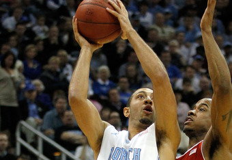 ATLANTA, GA - MARCH 10:  Kendall Marshall #5 of the North Carolina Tar Heels drives for a shot attempt against Lorenzo Brown #2 of the North Carolina State Wolfpack during their Semifinal game of the 2012 ACC Men's Basketball Conferene Tournament at Phili