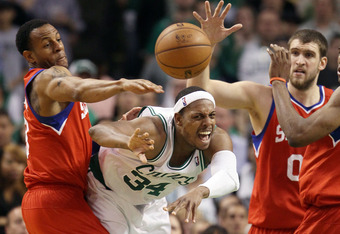 BOSTON, MA - MAY 12:  Paul Pierce #34 of the Boston Celtics passes the ball under pressure from Andre Iguodala #9 and Spencer Hawes #00 of the Philadelphia 76ers in Game One of the Eastern Conference Semifinals in the 2012 NBA Playoffs on May 12, 2012 at