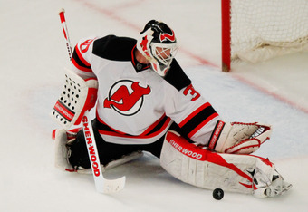 NEW YORK, NY - MAY 14:  Martin Brodeur #30 of the New Jersey Devils makes a pad save in the first period of Game One of the Eastern Conference Finals against the New York Rangers during the 2012 NHL Stanley Cup Playoffs at Madison Square Garden on May 14,