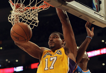 LOS ANGELES, CA - MARCH 29:  Andrew Bynum #17 of the Los Angeles Lakers dunks past Kevin Durant #35 of the Oklahoma City Thunder at Staples Center on March 29, 2012 in Los Angeles, California.  NOTE TO USER: User expressly acknowledges and agrees that, by