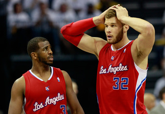 MEMPHIS, TN - MAY 13:  Chris Paul #3 and Blake Griffin #32 of the Los Angeles Clippers converse during a timeout against the Memphis Grizzlies in Game Seven of the Western Conference Quarterfinals in the 2012 NBA Playoffs at FedExForum on May 13, 2012 in