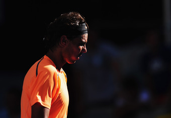 MADRID, SPAIN - MAY 10:  A dejected Rafael Nadal of Spain during his defeat to Fernando Verdasco of Spain in the 4th round of the Mutua Madrilena Madrid Open at the Caja Magica on May 10, 2012 in Madrid, Spain.  (Photo by Mike Hewitt/Getty Images)