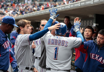 DETROIT, MI - APRIL 22: Elvis Andrus #1 of the Texas Rangers celebrates with his teammates after scoring on a sacrfice fly from Josh Hamilton #32 in the eight inning of the game against the Detroit Tigers at Comerica Park on April 22, 2012 in Detroit, Mic